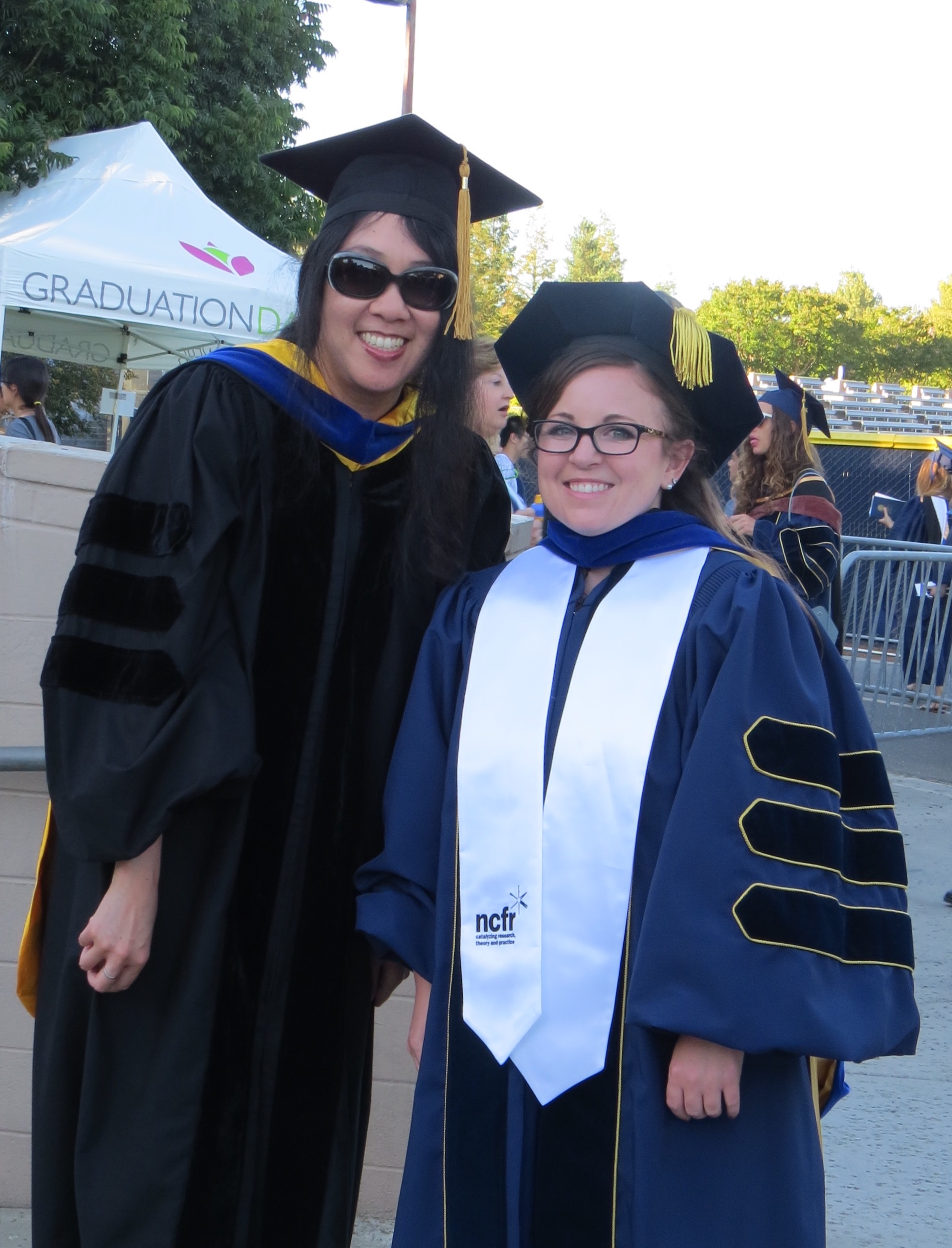 Carolyn with Dr. Adrienne Nishina at her PhD graduation ceremony.